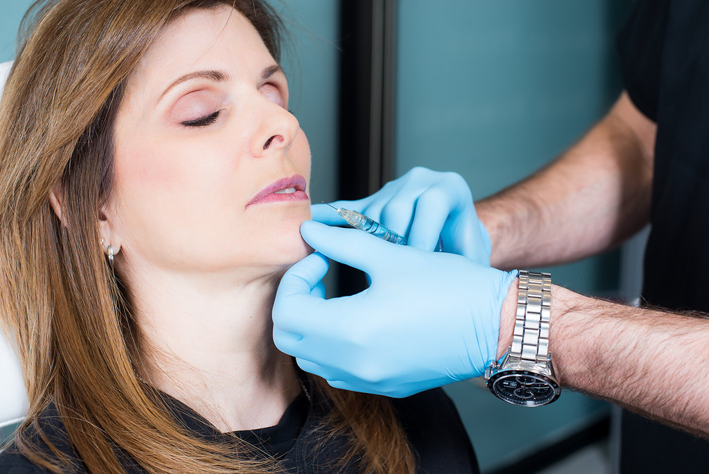 woman getting a lip injection